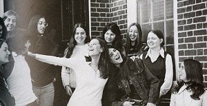 Female students gathered outside Clark Hall. From the 1972 Hullabaloo yearbook.