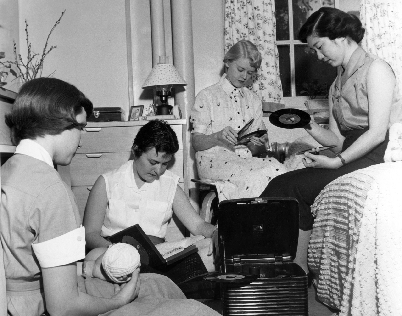 School of Nursing students playing records in bedroom at Hampton House